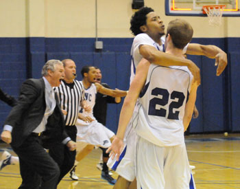 Chase Spreen (No. 22) gets mobbed by teammate Justin Archie after Spreen's game-winner.
