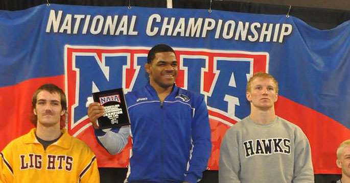 Jameel Bryant (center) is the MSC Wrestler of the Year