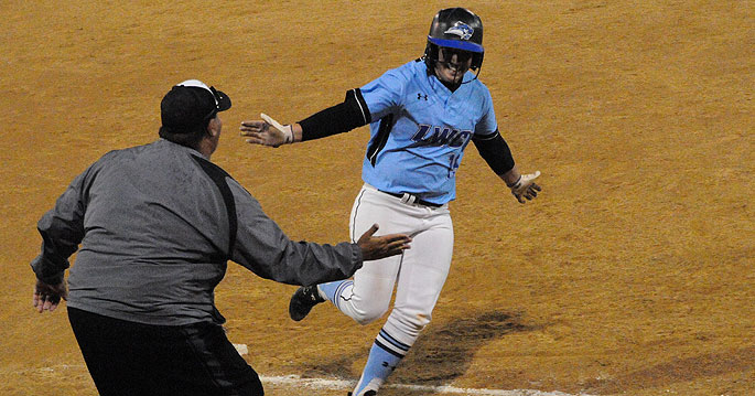 Amanda Trampe circles the bases after her walk-off home run in the bottom of the eighth