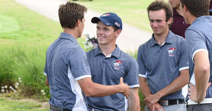 Ben Kendrick (middle) shot the low round of the day with an 8-under par 64